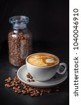 coffee cup and beans on wooden... | Shutterstock . vector #1040046910