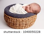 newborn baby sleeping in a... | Shutterstock . vector #1040050228