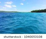 scene of tranquility island ... | Shutterstock . vector #1040053108
