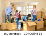 family unpacking things from... | Shutterstock . vector #1040054518