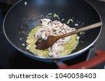 cooking champignon mushrooms...   Shutterstock . vector #1040058403