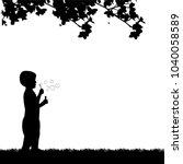 boy blowing soap bubbles in... | Shutterstock .eps vector #1040058589