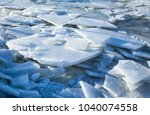 the layers of ice float along... | Shutterstock . vector #1040074558