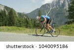pro road cyclist enduring a... | Shutterstock . vector #1040095186