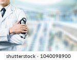 young man doctor holding... | Shutterstock . vector #1040098900