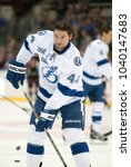 Small photo of UNIONDALE, NEW YORK, UNITED STATES – April 6, 2013: NHL Hockey: Nate Thompson with some Tampa Bay Lightning teammates during warm-ups. Versus New York Islanders at Nassau Veterans Memorial Coliseum.