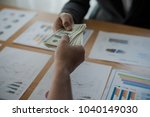 men's hands  sending money to... | Shutterstock . vector #1040149030