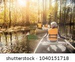 canoeing down beautiful river... | Shutterstock . vector #1040151718
