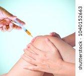 doctor hand holding syringe of... | Shutterstock . vector #1040152663