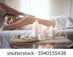 beautiful woman getting a salt...   Shutterstock . vector #1040155438