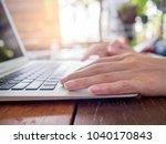 businesswoman typing on laptop... | Shutterstock . vector #1040170843