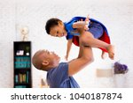 father lifting son up with... | Shutterstock . vector #1040187874