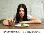 sad young brunette woman... | Shutterstock . vector #1040210548