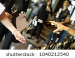 the waitress was pouring a... | Shutterstock . vector #1040212540
