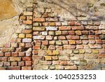 the wall of an old brick house. ... | Shutterstock . vector #1040253253