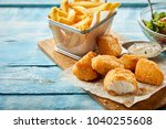 rustic serving of crumbed fried ... | Shutterstock . vector #1040255608