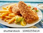 crispy fish fillet fried in a... | Shutterstock . vector #1040255614