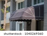 Small photo of awning mounted on the front door of the shop.