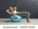 fitness woman working on her... | Shutterstock . vector #1040272204
