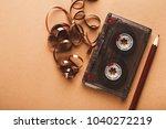 retro audio cassette and pencil ... | Shutterstock . vector #1040272219