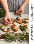 cooking healthy vegetarian... | Shutterstock . vector #1040274844