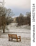 outdoor scene of a park bench... | Shutterstock . vector #1040275114