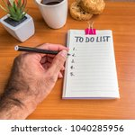 hand of man writting on empty... | Shutterstock . vector #1040285956