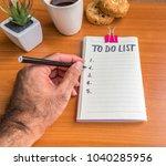 hand of man writting on empty... | Shutterstock . vector #1040285956