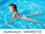 activities on the pool  little... | Shutterstock . vector #1040303710