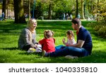 Small photo of BREDA, NETHERLANDS - May 5, 2016: An undentified young Iraqi refugee family celebrates the Dutch National Liberation Day sitting and picnicing in the grass of the Valkenberg Park in Breda.