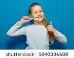 smiling girl holding three... | Shutterstock . vector #1040336608