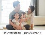 happy parents and children... | Shutterstock . vector #1040339644