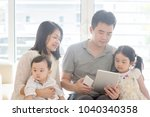 father using tablet pc and... | Shutterstock . vector #1040340358