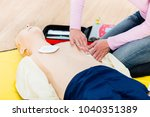 first aider trainee learning... | Shutterstock . vector #1040351389