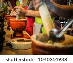 preparing spicy thai papaya... | Shutterstock . vector #1040354938