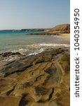 lanzarote  sandy beach on the... | Shutterstock . vector #1040354950