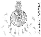 dreamcatcher with owl.... | Shutterstock . vector #1040357440