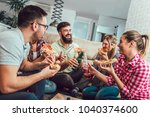 group of young friends eating... | Shutterstock . vector #1040374600
