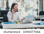 intern at the office working on ... | Shutterstock . vector #1040377066