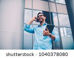 happy positive entrepreneur in... | Shutterstock . vector #1040378080