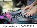 close up of dj's hand playing... | Shutterstock . vector #1040379913