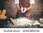 man preparing bread dough on... | Shutterstock . vector #1040380036