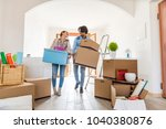 couple moving to a new home  ... | Shutterstock . vector #1040380876