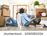 couple moving to a new home  ... | Shutterstock . vector #1040381026