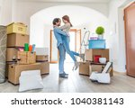 couple moving to a new home  ... | Shutterstock . vector #1040381143