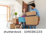 couple moving to a new home  ... | Shutterstock . vector #1040381233