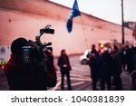 camera man is shooting a film... | Shutterstock . vector #1040381839