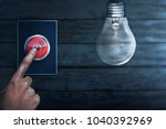 people hands turning off bulb...   Shutterstock . vector #1040392969