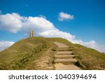 Glastonbury Tor in Somerset, United Kingdom, with the ruins of St Michael's Church demolished in 1539 during the Dissolution of the Monasteries - stock photo