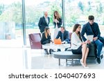 a business team sitting in... | Shutterstock . vector #1040407693